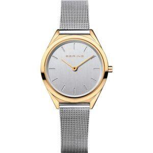Kvarts ur med sølv skive